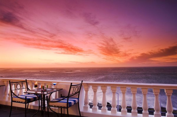 Keep an eye out for whale when sipping on cocktails at The 12 Apostles Hotel and Spa. © Red Carnation