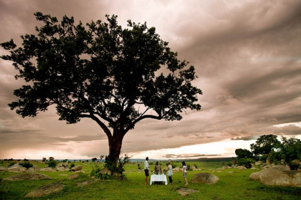 Having sundowners under a moody sky is one of the many pleasures at Serengeti Mobile Camp. © Legendary Expeditions