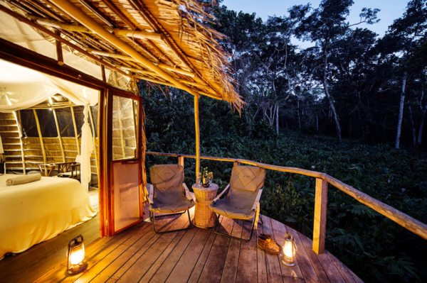 Enjoy sundowners on your chalet's deck at Ngaga Camp. © Odzala Discovery Camps