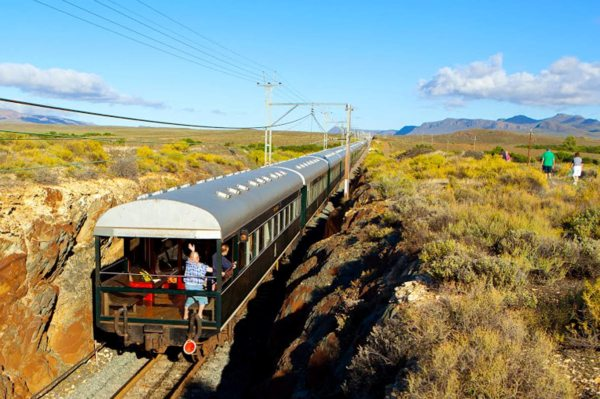 You'll find yourself waving to any people you pass in the stark Karoo. © Rovos Rail