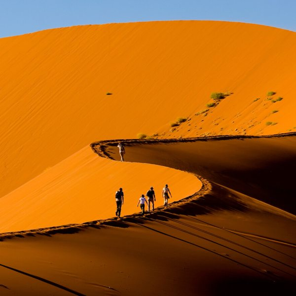 Namibia is famous for its huge, red dunes, as you'll see at Sossusvlei.
