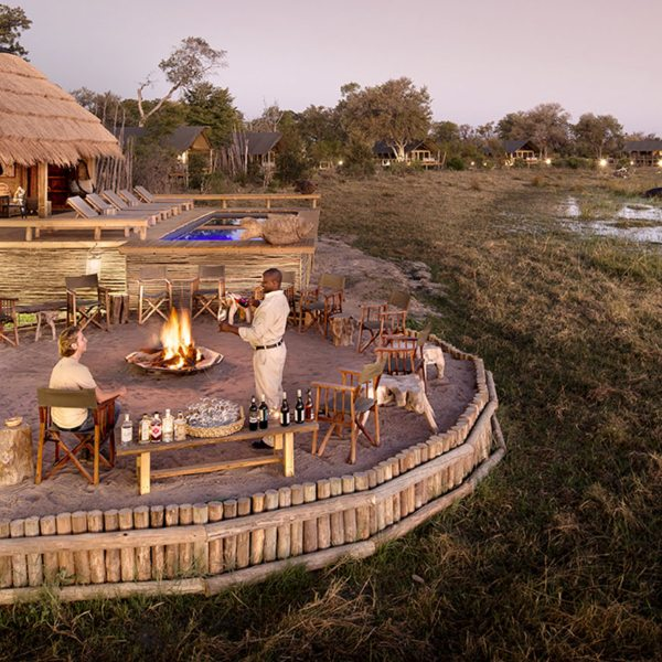 Unwind with sundowners in the boma at Sable Alley. © Natural Selection