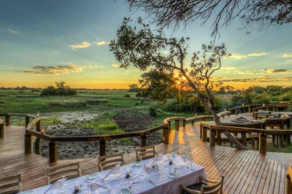 Dine al fresco at Camp Okavango. © Desert & Delta Safaris