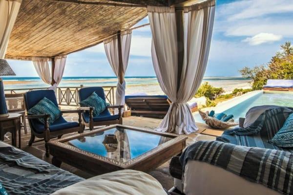 The poolside lounge at Alfajiri Cliff Villa is perfect for lazy days. © Alfajiri Villas