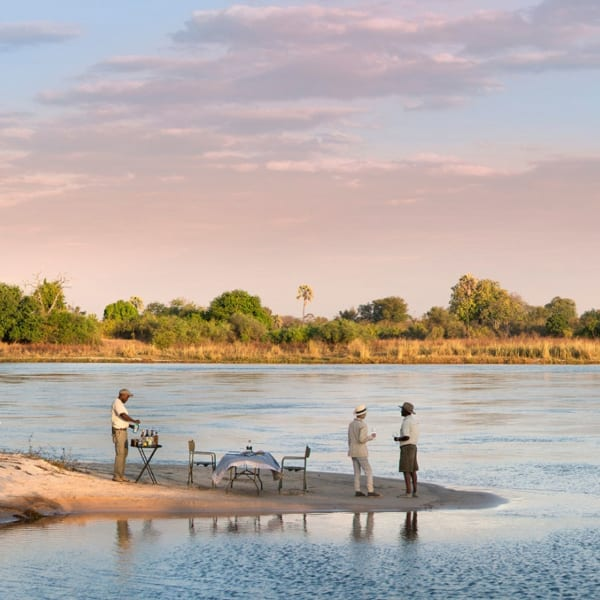 Have a picnic on a river island at Thorntree River Lodge. © African Bush Camps