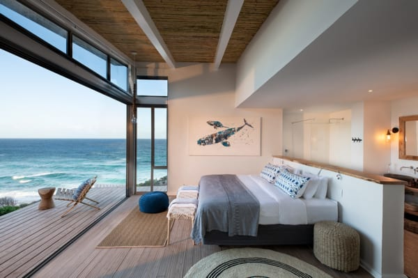 Gaze at the ocean from your bed at Lekkerwater Beach Lodge. © Lekkerwater Beach Lodge